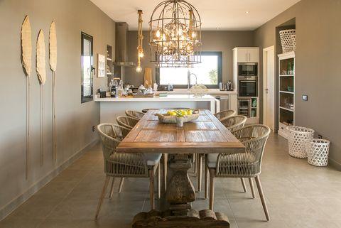 Mediterranean style kitchen-diner in earth tones