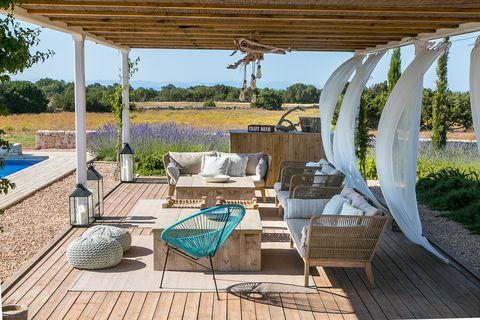 porch with natural fiber furniture
