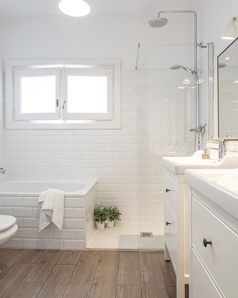 white floor and modern bathroom with bathtub and shower