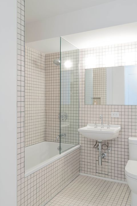 minimalist bathroom decorated with mini tiles in white