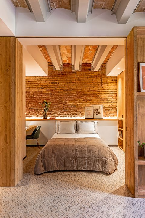 industrial style apartment decorated with wood and exposed brick