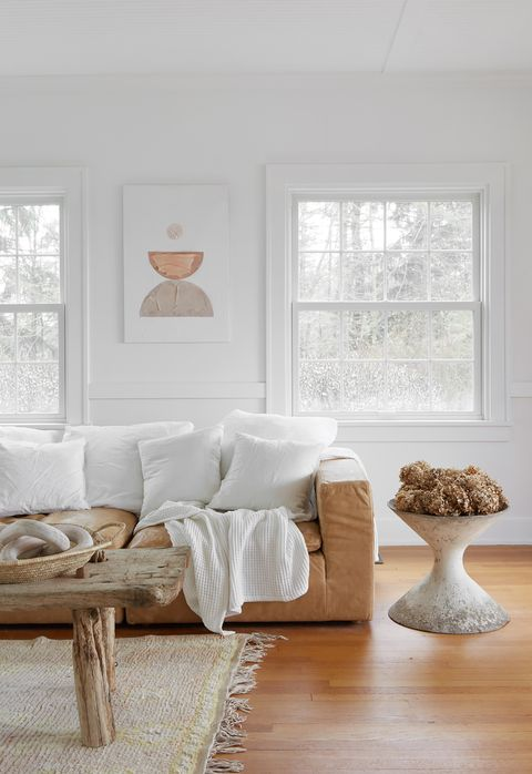 farmhouse chic living room with camel leather sofa and raw wood coffee table