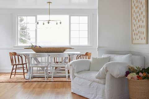 farmhouse chic dining room with white wood table