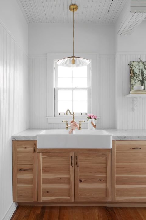 chic farmhouse style kitchen with rustic sink and wood countertop