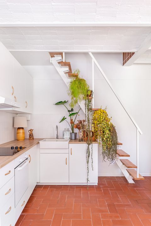 open staircase decorated with ferns