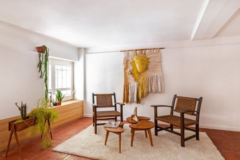 living room decorated with macrame tapestry