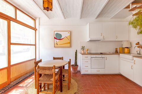 open kitchen with dining area decorated with natural fiber pieces