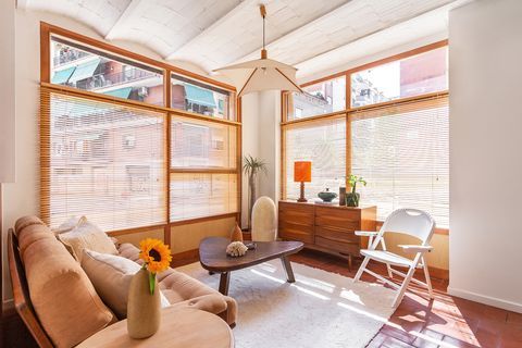 living room decorated in ocher and earth tones with vintage furniture
