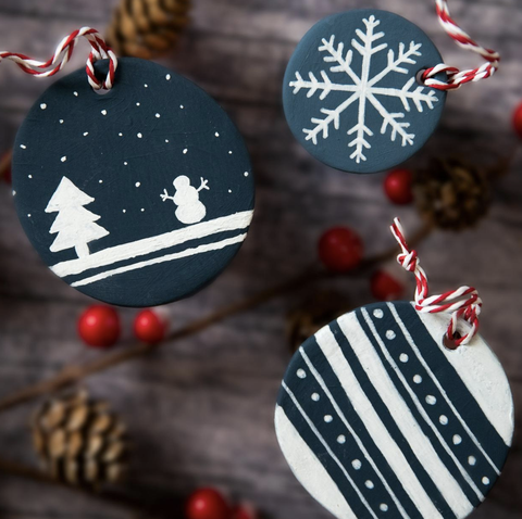 made of airy clay painted with acrylics has a red-white rope attached to hang it on your tree the two large ones are 7 cm and the small one is 4.5 cm