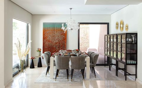 contemporary designed dining room in neutral tones decorated with a tapestry