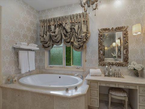classic style bathroom with bathtub