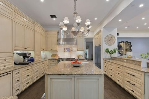 classic style open kitchen with central island