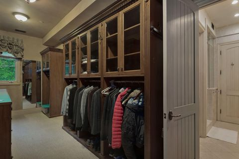 classic style walk-in wardrobe with wooden cabinets