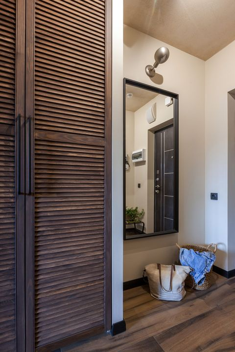 entrance hall decorated in earth tones with wooden floors