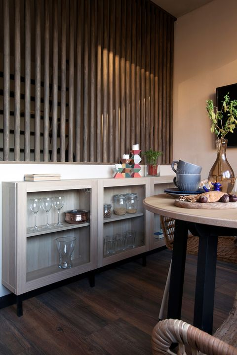 wooden sideboard with dishes in the dining room