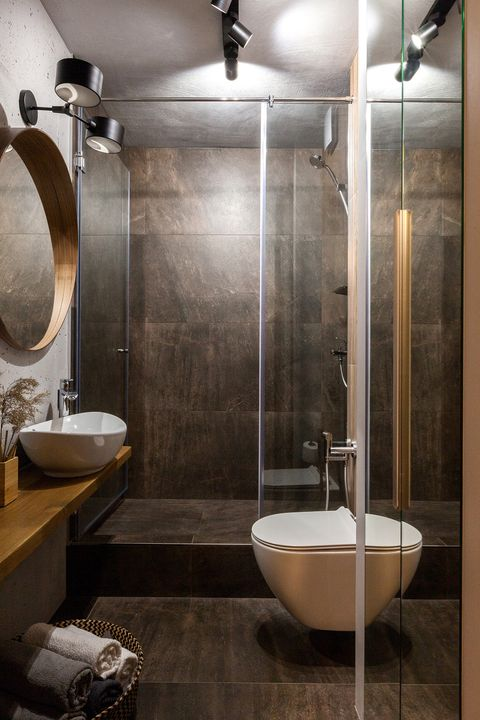 bathroom with shower built in stone and floating wooden countertop