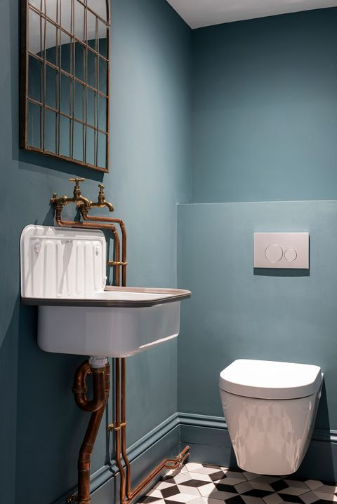 industrial style toilet with blue walls