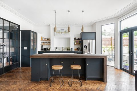 open kitchen with central island and wooden worktop