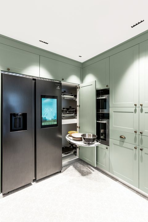 dusty green kitchen cabinets with built-in appliances