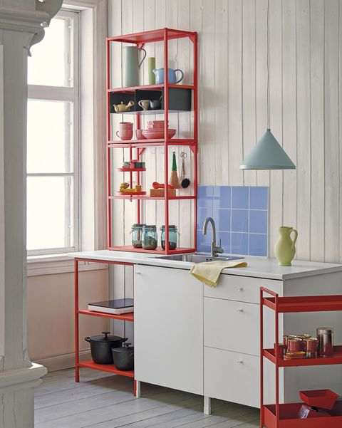 modern white kitchen with red shelving