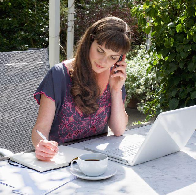 woman teleworking in the garden