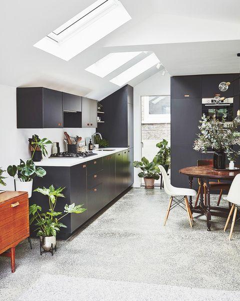 modern attic kitchen in black and white