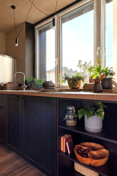 open kitchen with wooden worktop and black doors