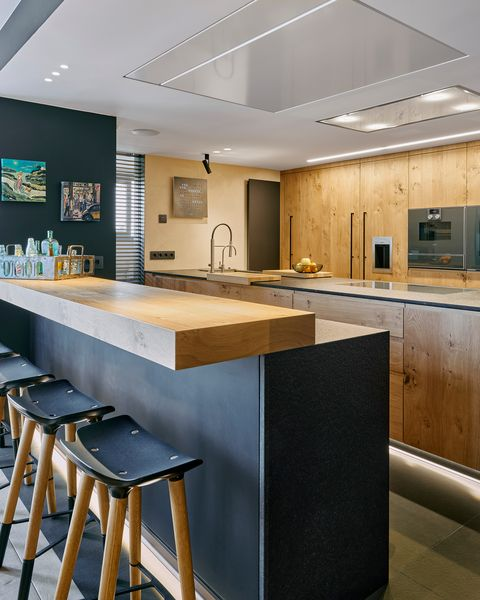 kitchen with industrial design bar in wood and black