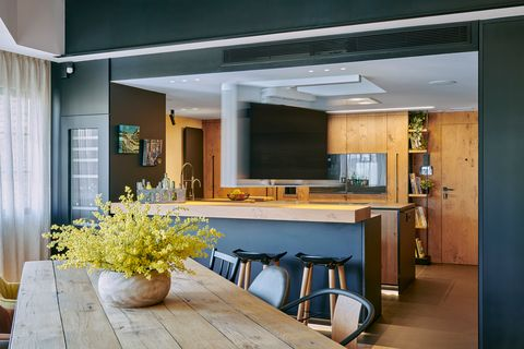 kitchen with bar open to the dining room in industrial design