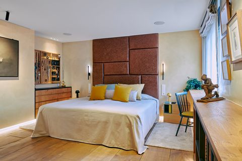 bedroom with leather upholstered headboard