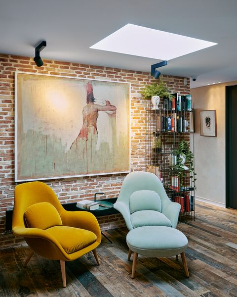 industrial style reading nook with two velvet armchairs