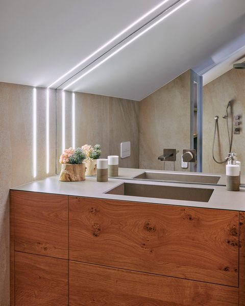modern bathroom with handleless wooden cabinet
