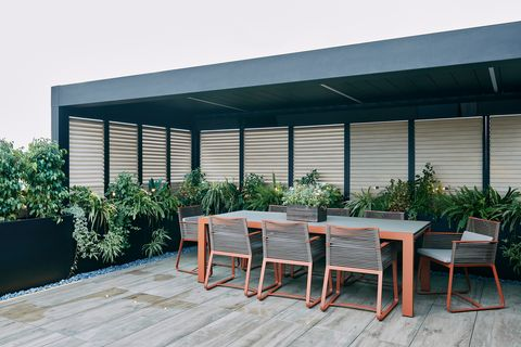 terrace with pergola and dining table