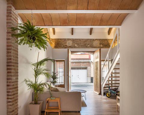 hall with reclaimed wood door