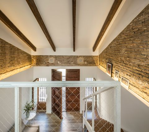 double height room with exposed wooden beams