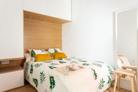 Nordic bedroom with built-in wardrobe in white and wood
