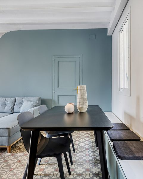 a vintage and cool apartment in barcelona dining room with bench storage space