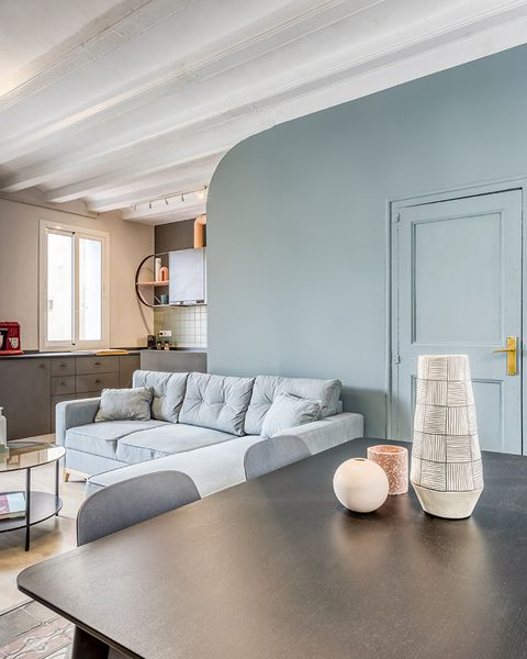 a cool vintage apartment in barcelona turquoise blue painted curved wall