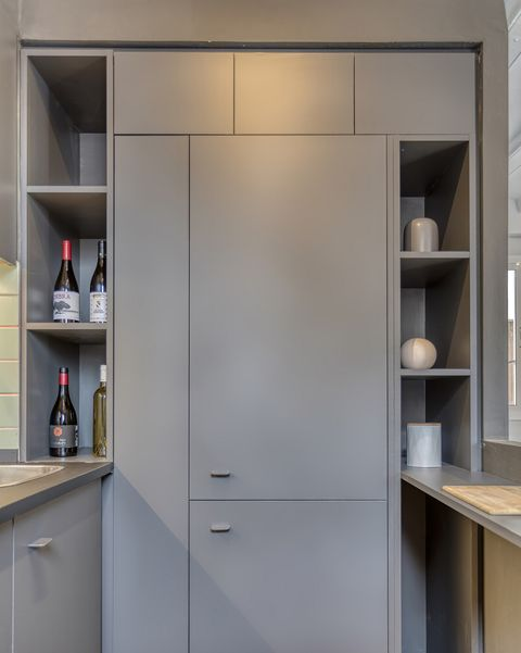 a cool vintage apartment in barcelona paneled fridge