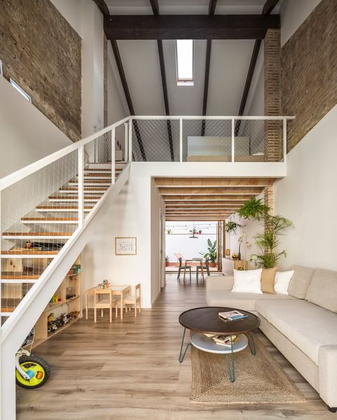 living room with double height and metal stairs