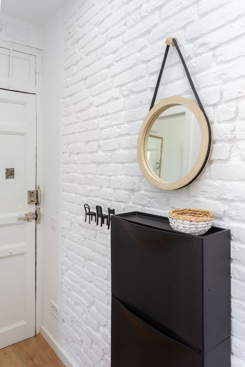 Nordic style hall with exposed brick wall in white