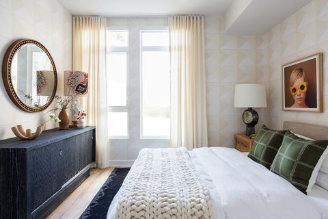 chic and feminine bedroom with geometric wallpaper