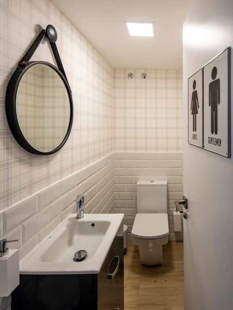 black and white decorated bathroom with subway tiles