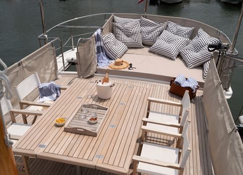 teak deck with dinette and seating area