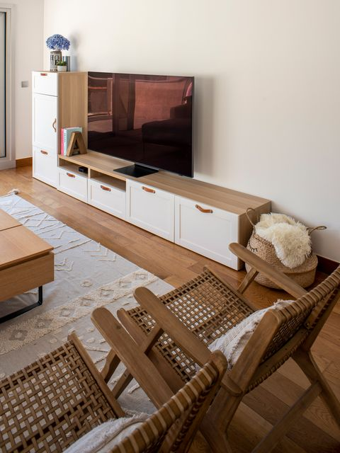 wooden tv cabinet with white doors and leather handles