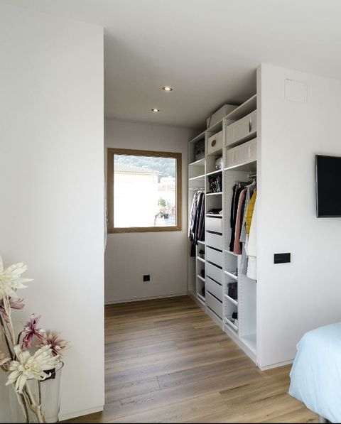 the most sustainable house in europe is spanish dressing room of the master bedroom