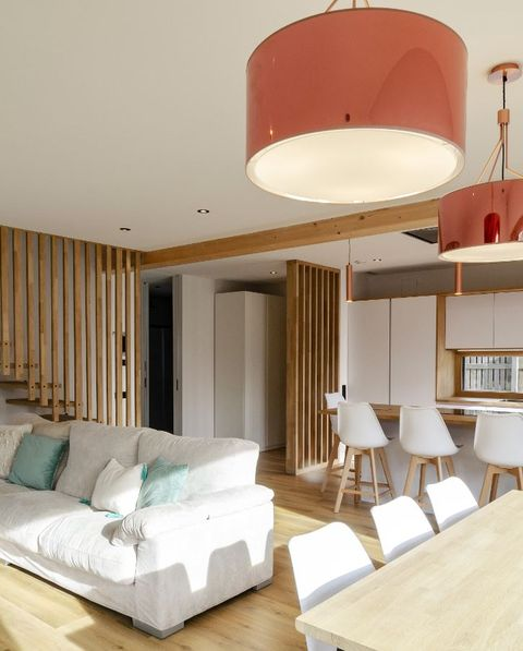 the most sustainable house in europe is spanish living room, dining room and kitchen