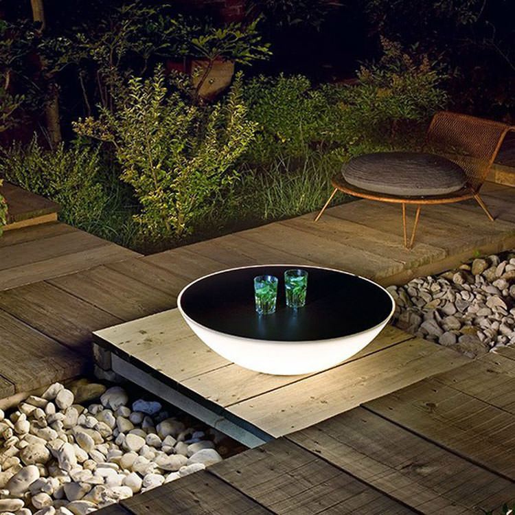 Garden table with built-in lamp