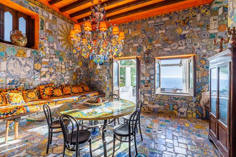 dining room with mosaic walls and floor
