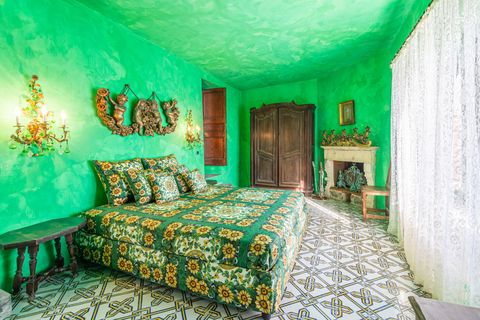 bedroom decorated in green with antique furniture